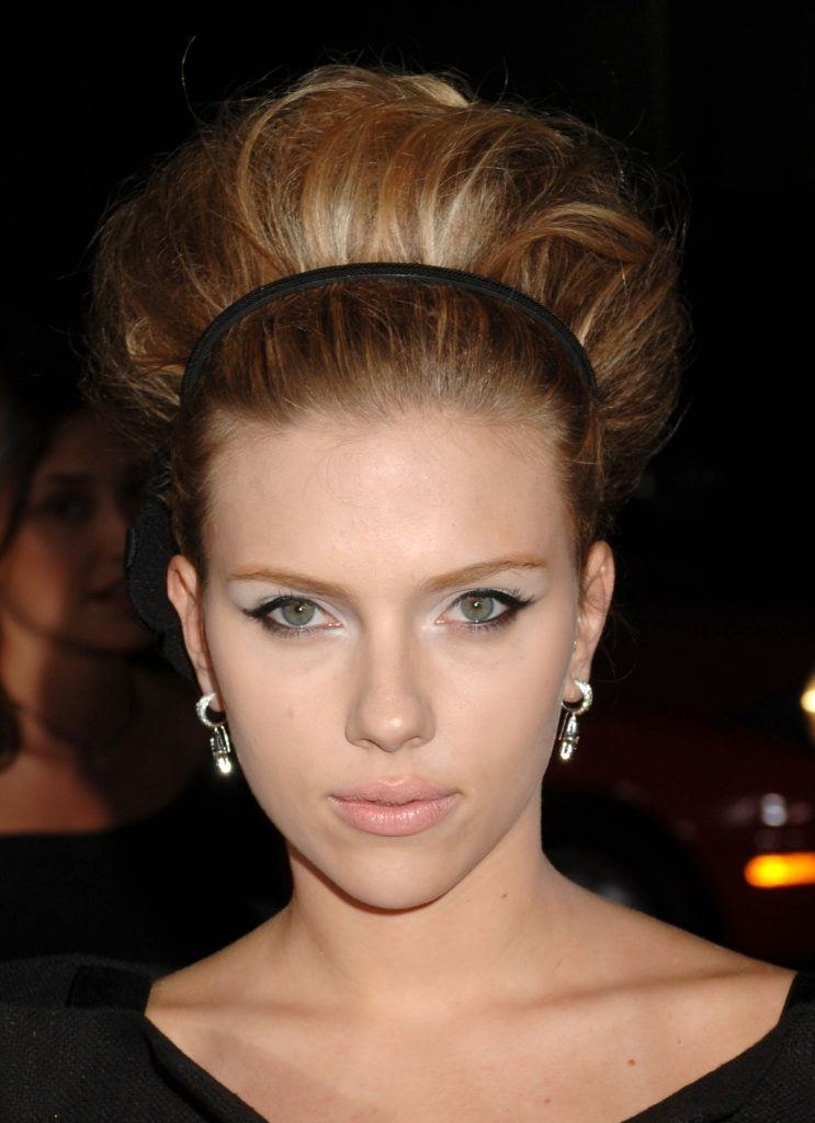 coiffed hair: scarlett johansson with her blonde hair in a 60s hairstyle with a black headband