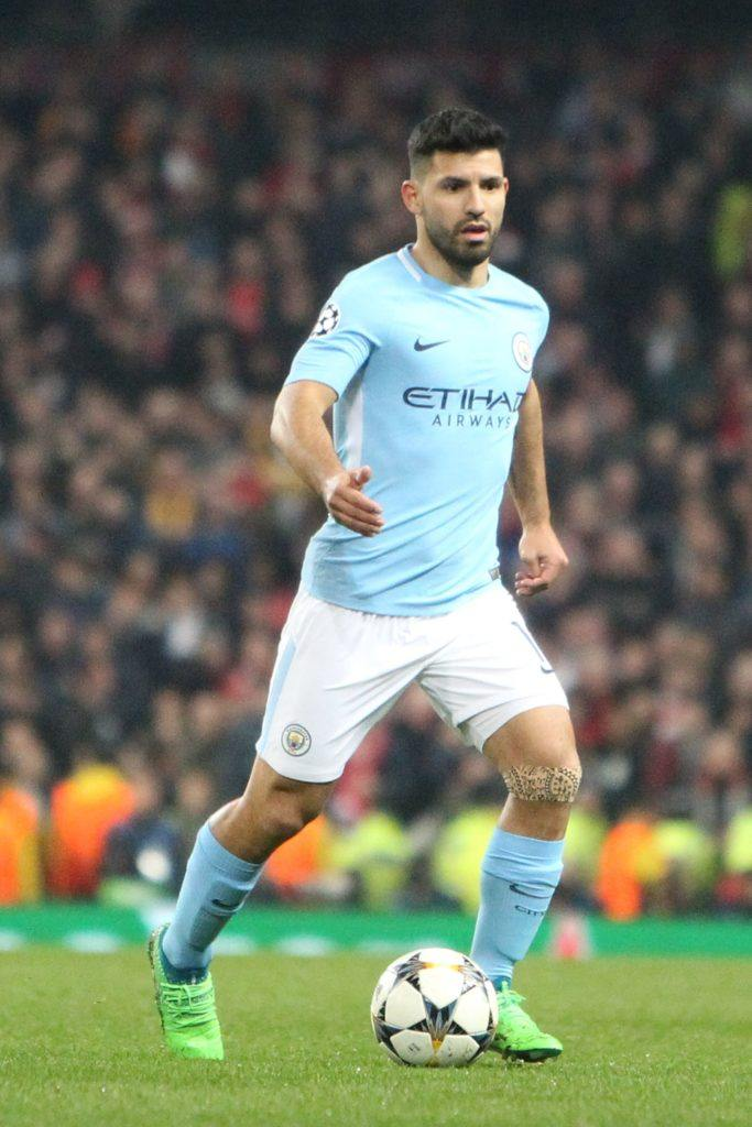 mid-game picture of argentinian footballer and manchester city player sergio aguero with a high fade textured top haircut