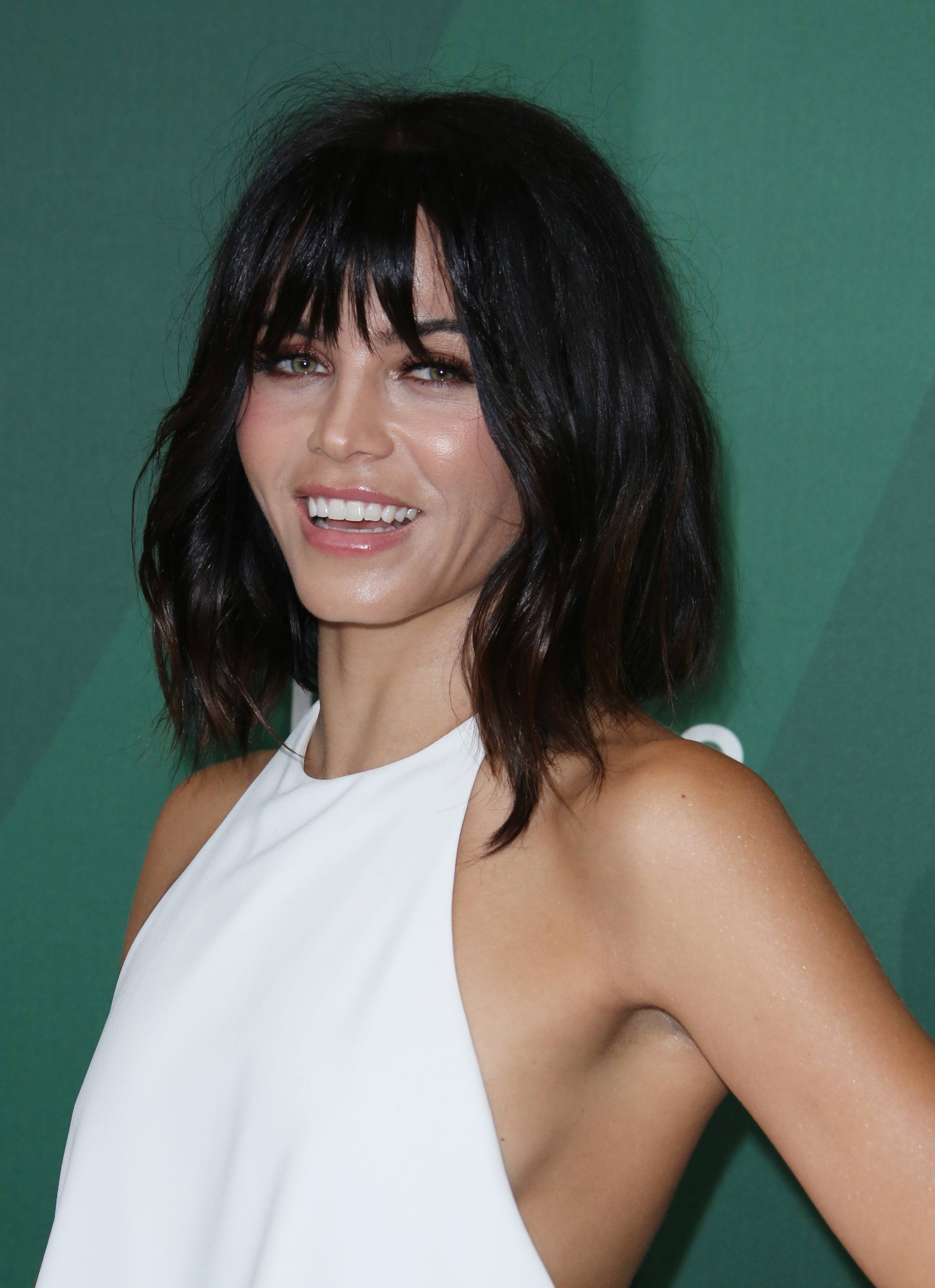 hairstyles for fine curly hair: jenna dewan with her dark hair in a shag cut long bob with peekaboo fringe