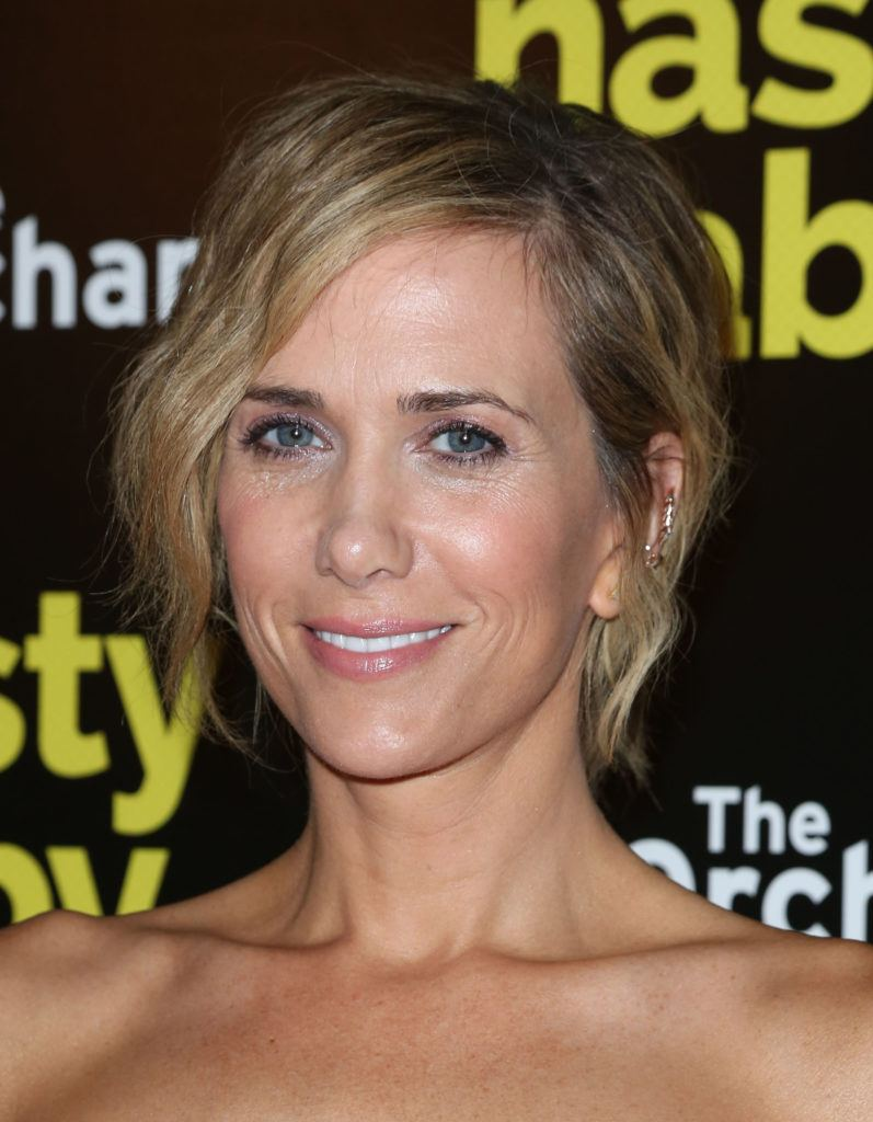 hairstyles for fine curly hair: kristen wiig with short curly blonde bobbed hair