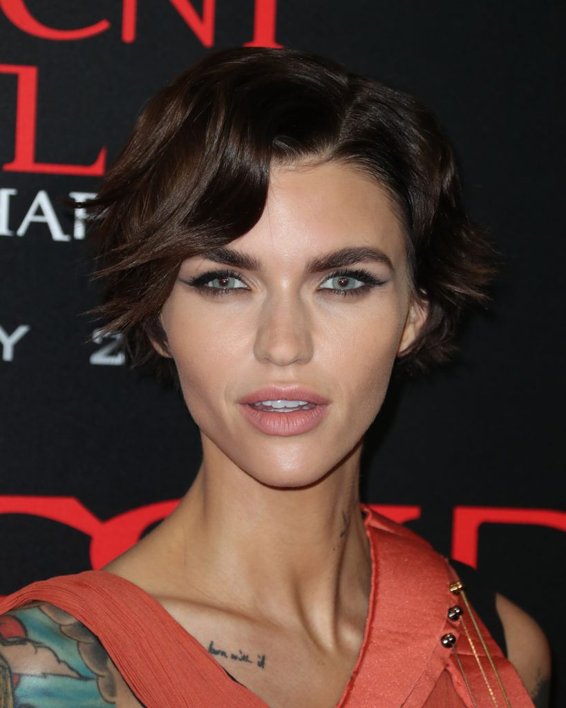 hairstyles for fine curly hair: ruby rose with her dark hair in a short curly pixie cut