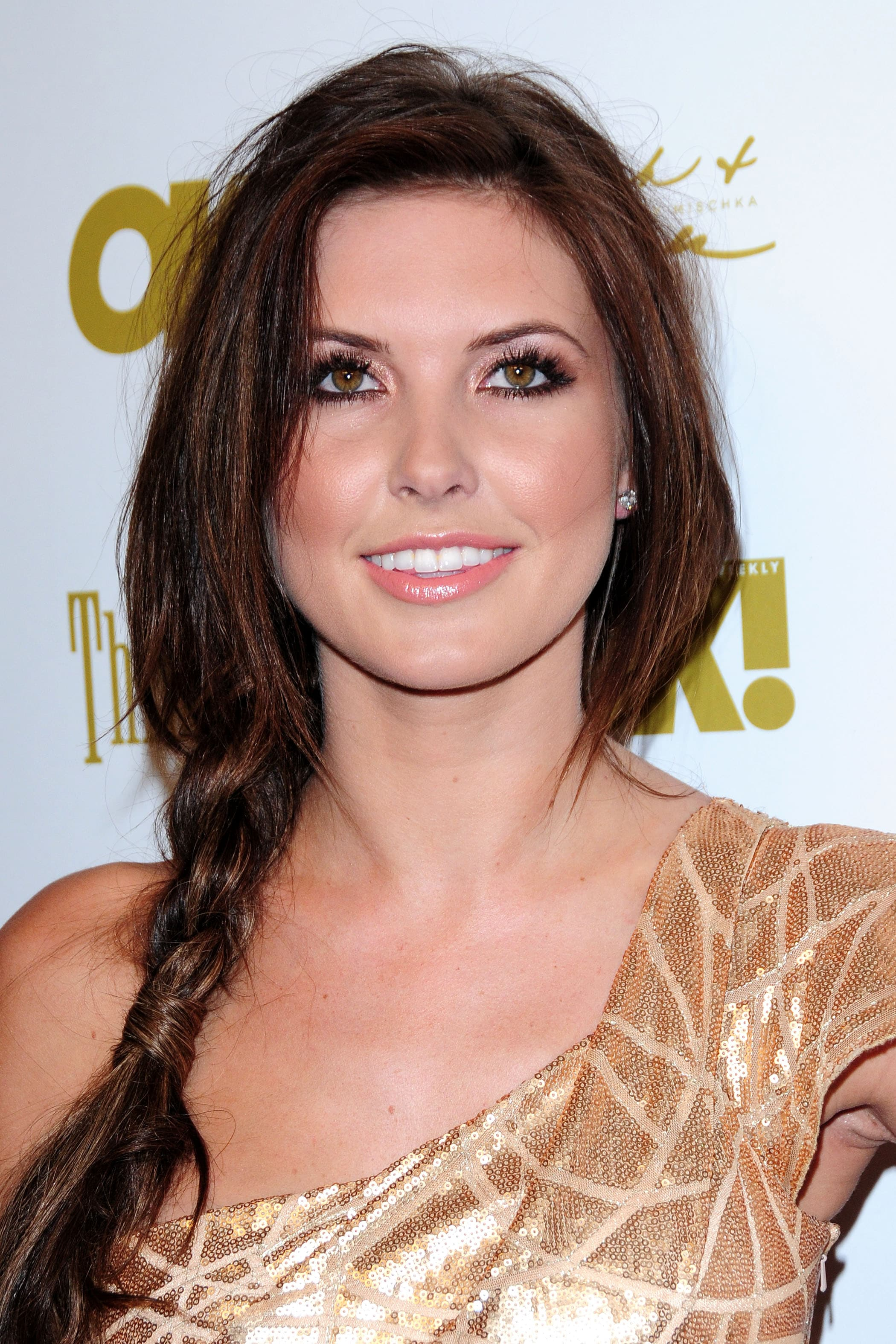 Audrina Patridge from MTV's The Hills on the red carpet with her dark brunette hair in a loose side braid