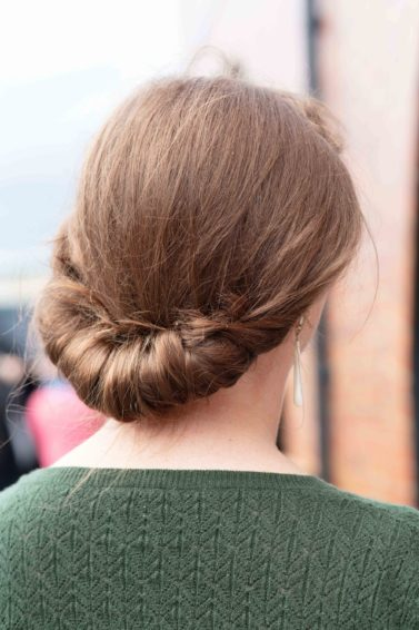 Vintage updo hairstyles: Back view of a brunette with a vintage Gibson tuck hairstyle