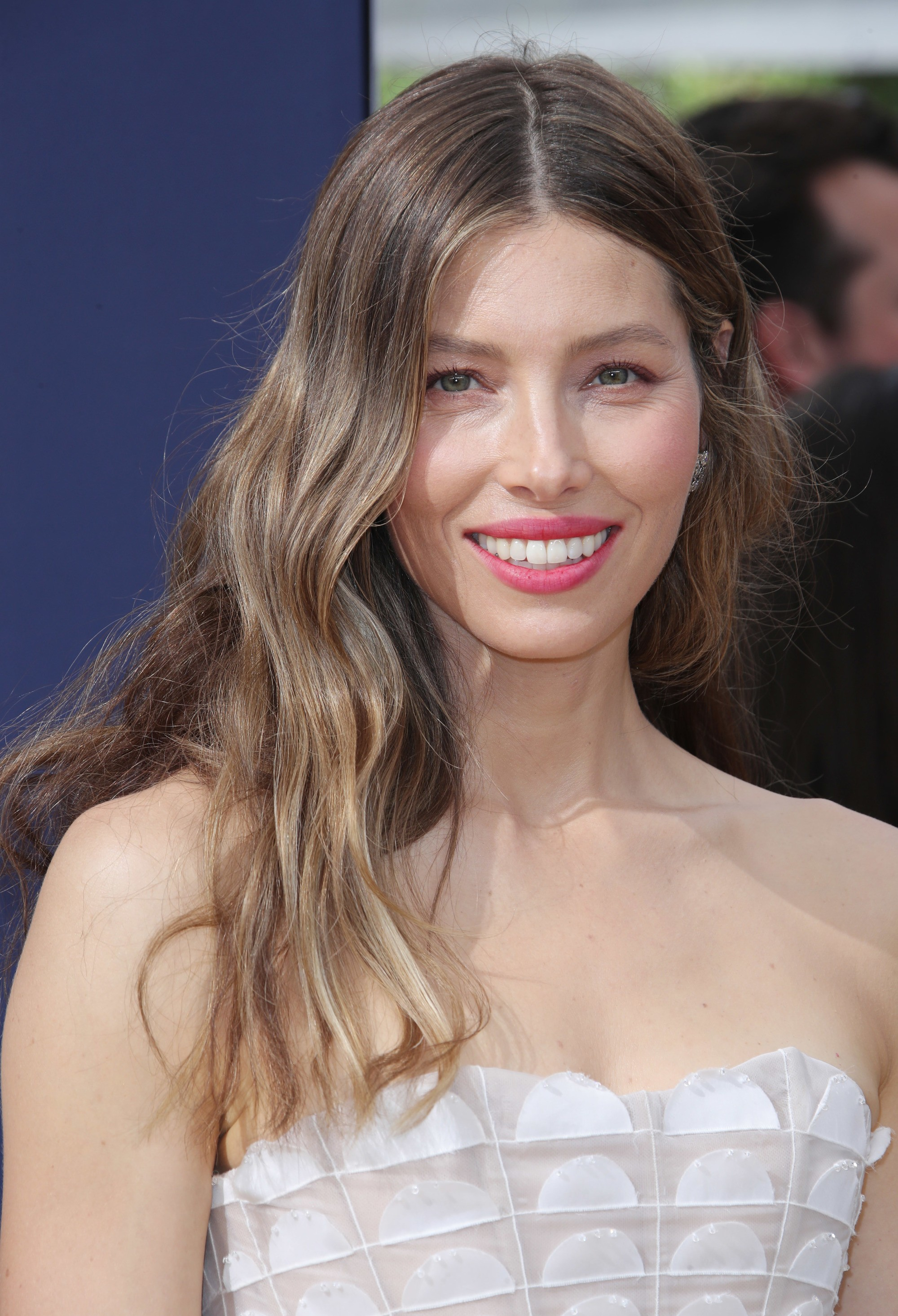 Jessica Biel with ash brown hair with sandy caramel hair, wearing white top on the red carpet