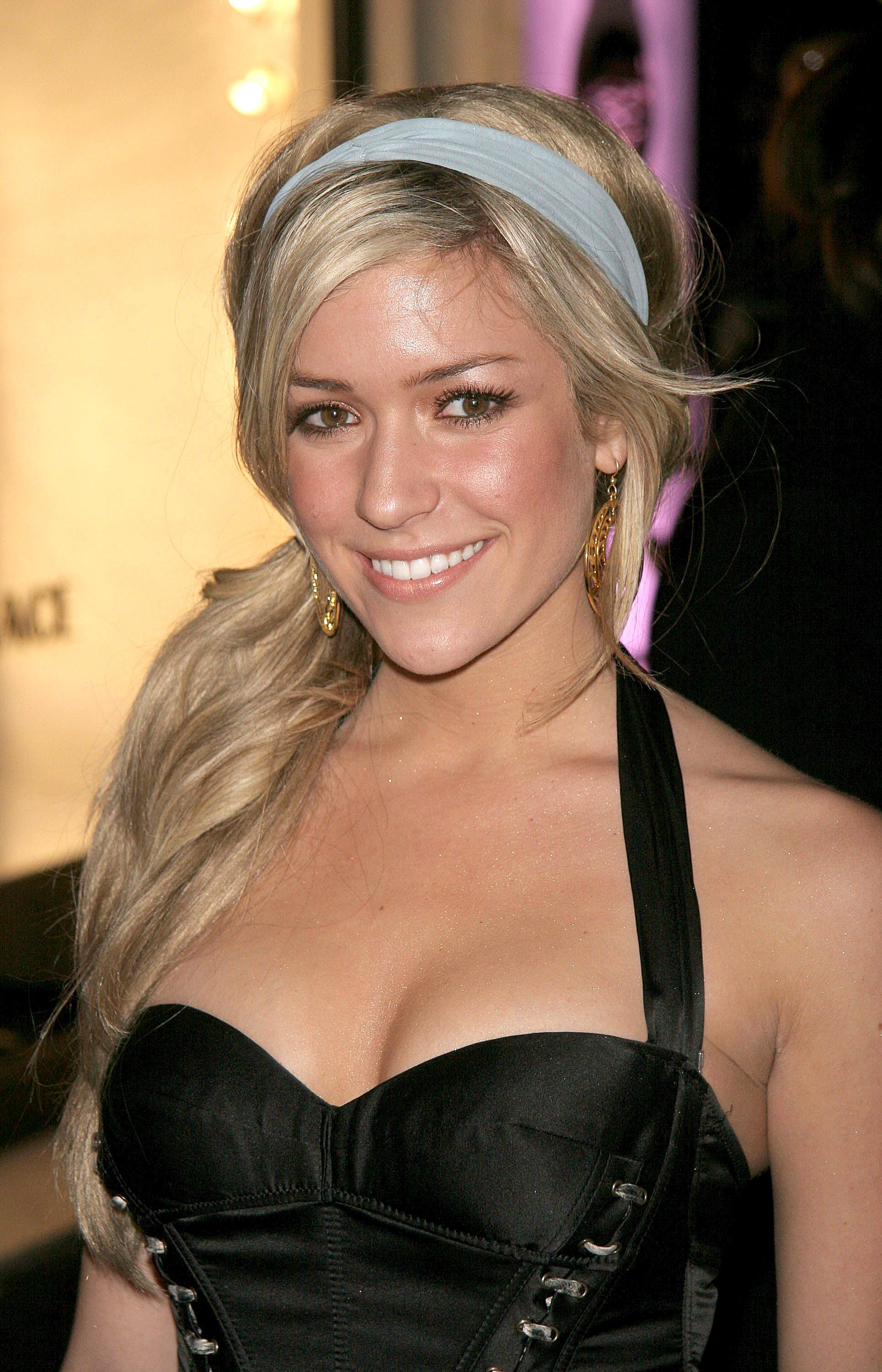 Kristin Cavallari from MTV's The Hills with her creamy blonde hair in a wavy low side ponytail with a grey headband