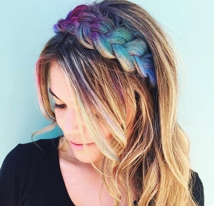 Crown hair: Close up shot of a woman with dirty blonde hair with a crown braided headband with glitter sprinkled on it