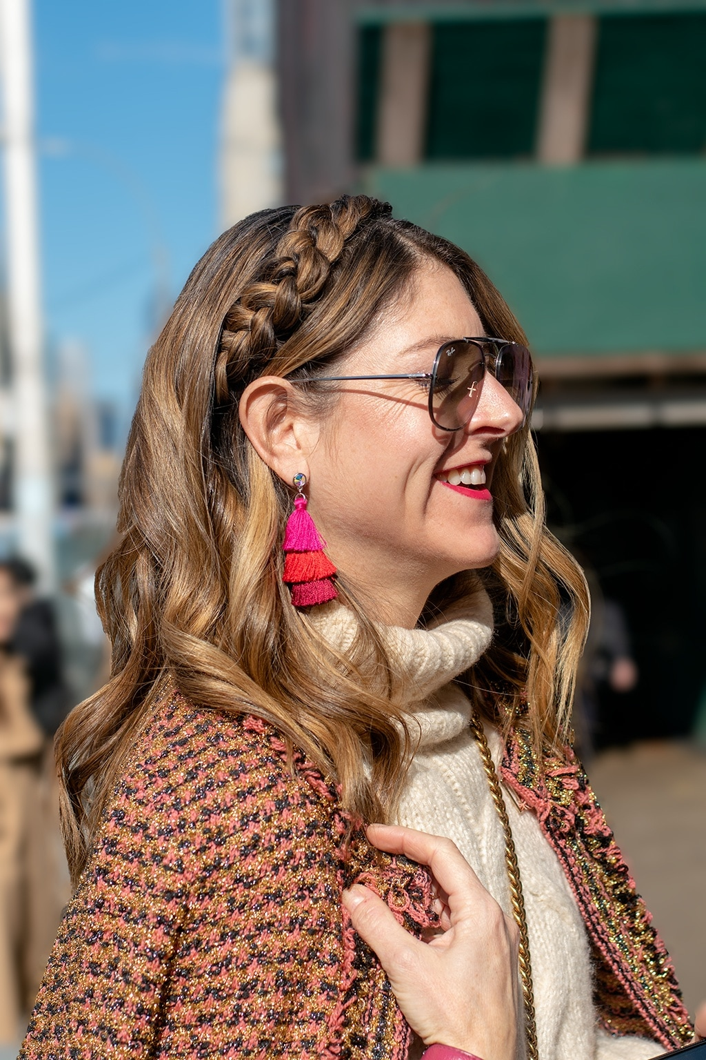 NYFW AW19 Street Style: Shot of woman with dirty blonde ombre hair with headband braid, tassel earrings with turtleneck jumper and boucle print coat