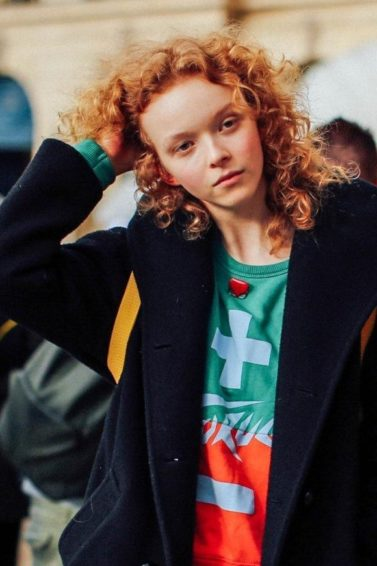 Hair treatment guide: Two models with ginger and brown medium curly hair, wearing winter jackets
