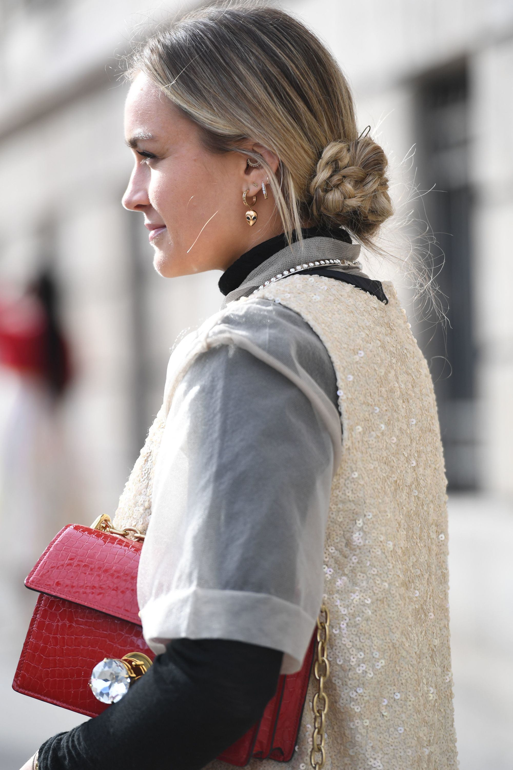 Blonde street styler with a low braided bun