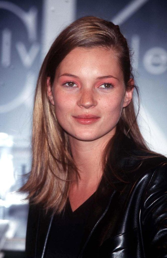 Kate Moss with natural blonde medium length hair in side parting in the '90s.