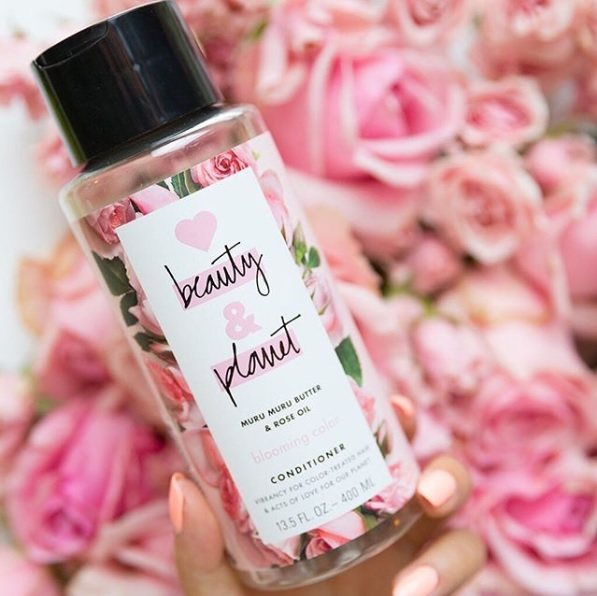 Love Beauty And Planet Instagram shot of the Blooming Colour Conditioner on a background of pink roses