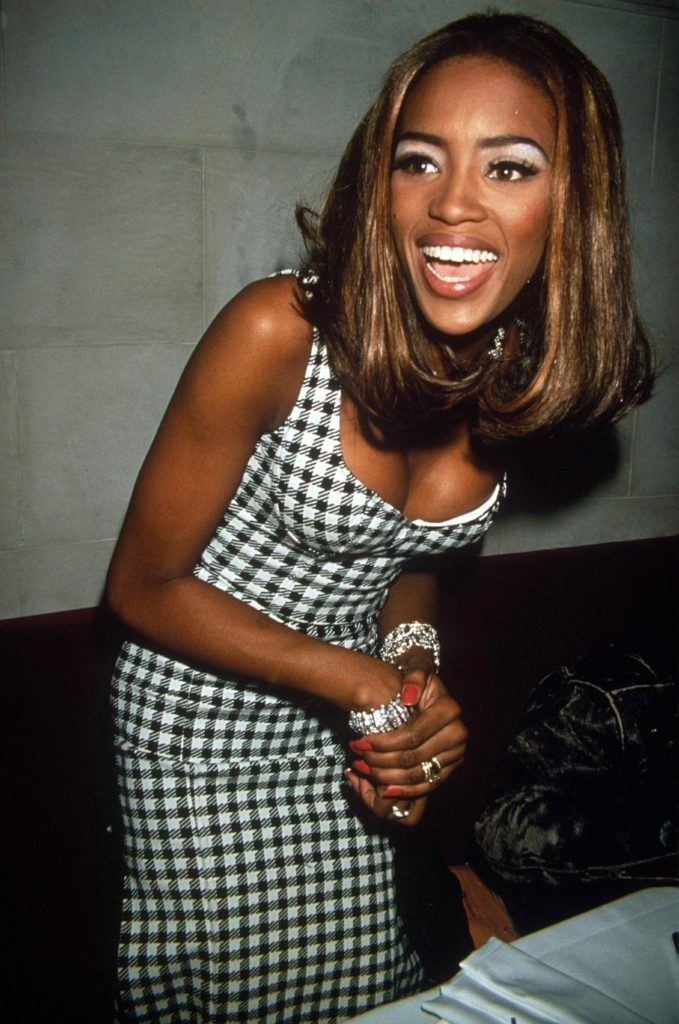 Naomi Campbell with medium length long bob with curled under ends wearing a black and white dress in the '90s
