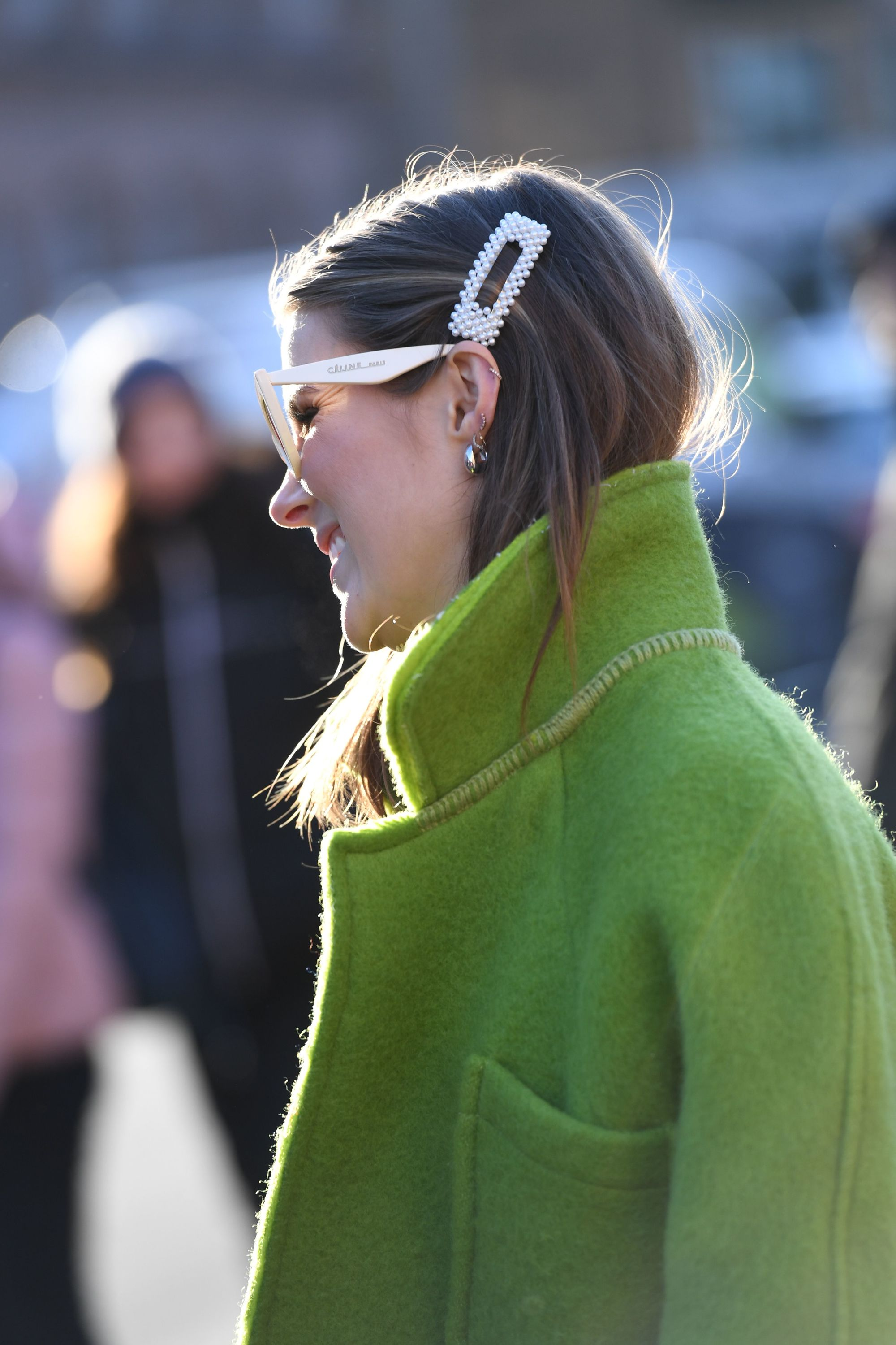 2019 Hair accessories: Street style shot of woman with her hair tucked into a green jacket. wearing a pearl hair clip with sunglasses at Copenhagen fashion week
