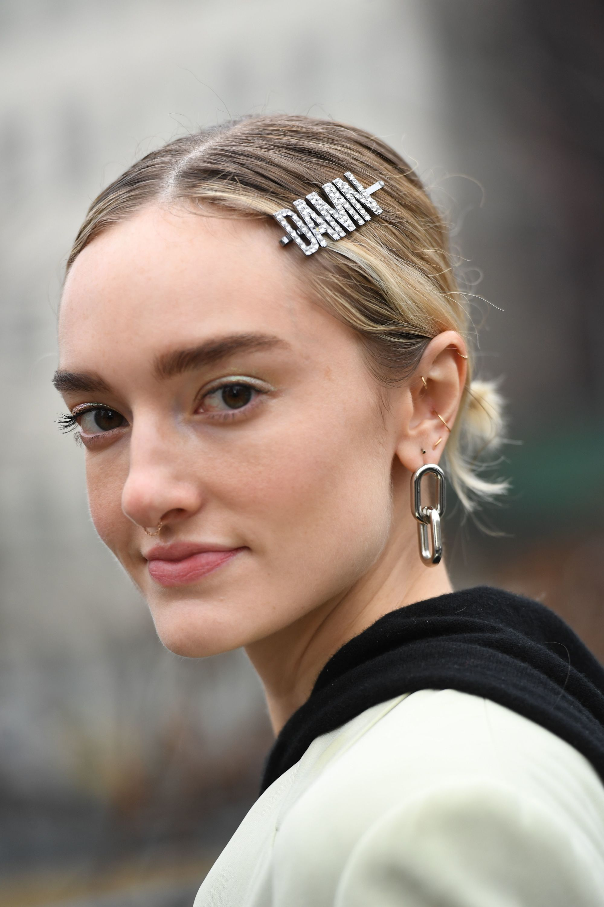 b8b8b614fe08 2019 hair accessories  Close-up street style photo of a blonde woman with  her