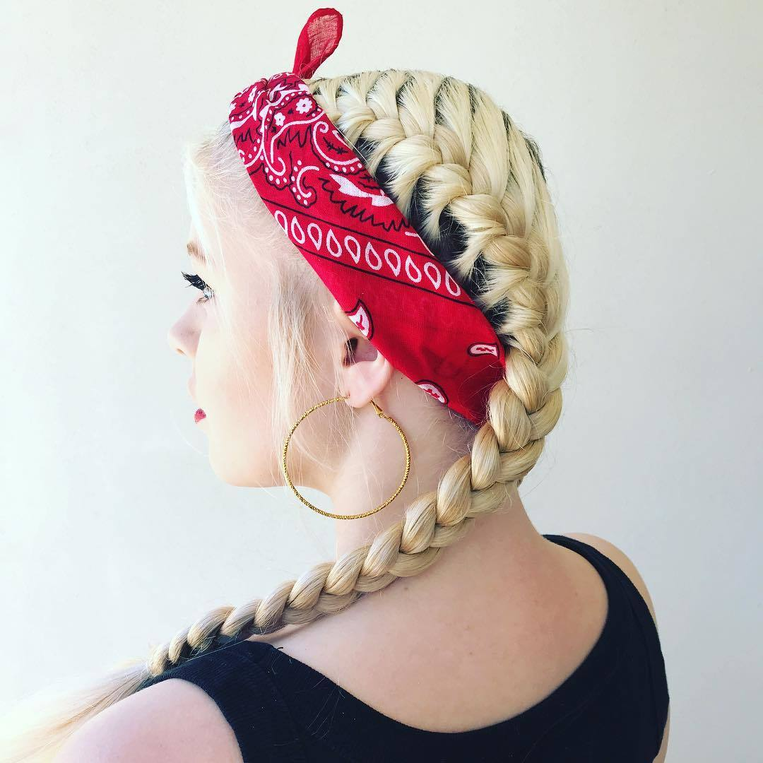 Bandana hairstyles: Woman with yellow blonde French braids with a red bandana tied around her head
