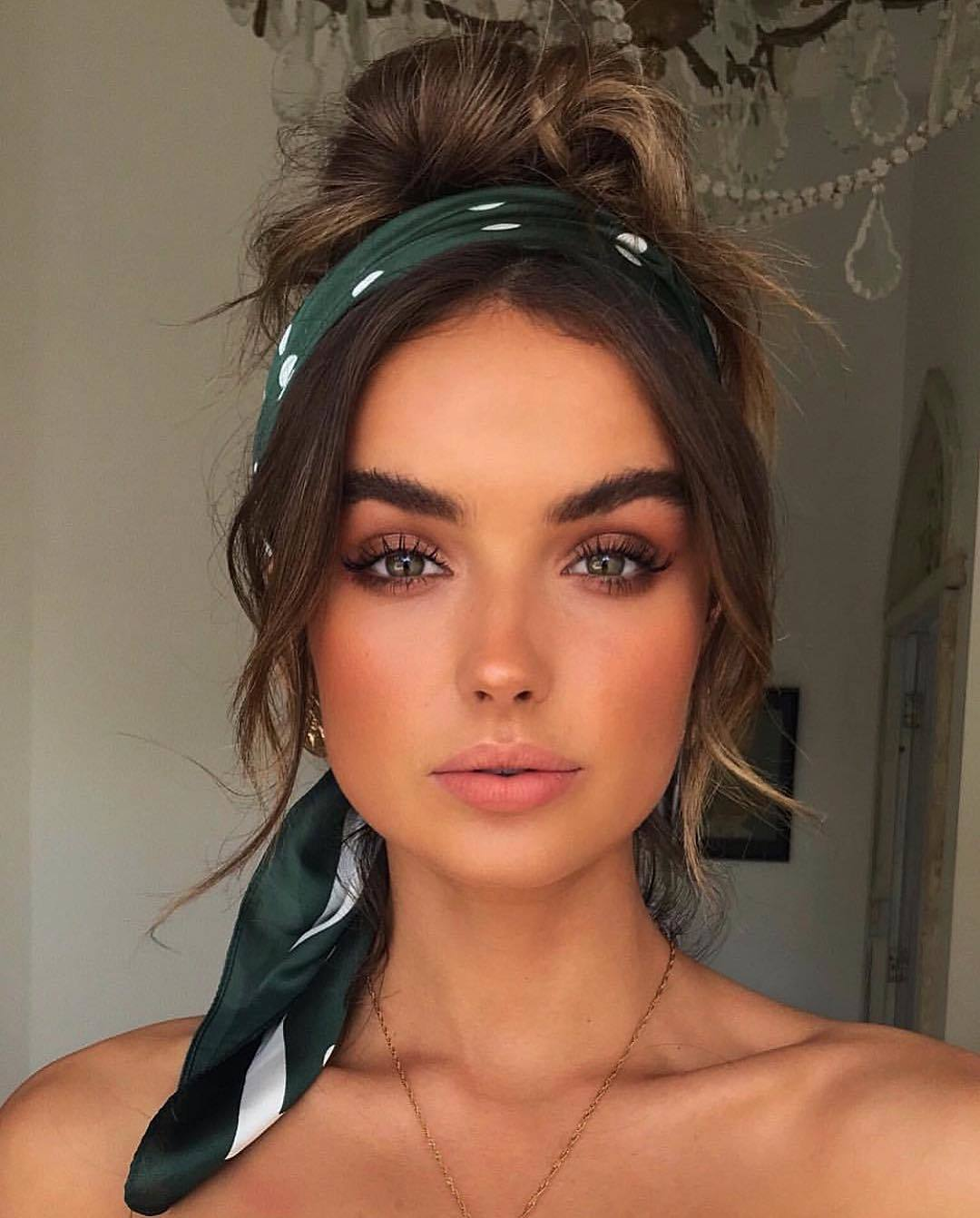 Bandana hairstyles: Woman with honey brown hair styled into a messy bun