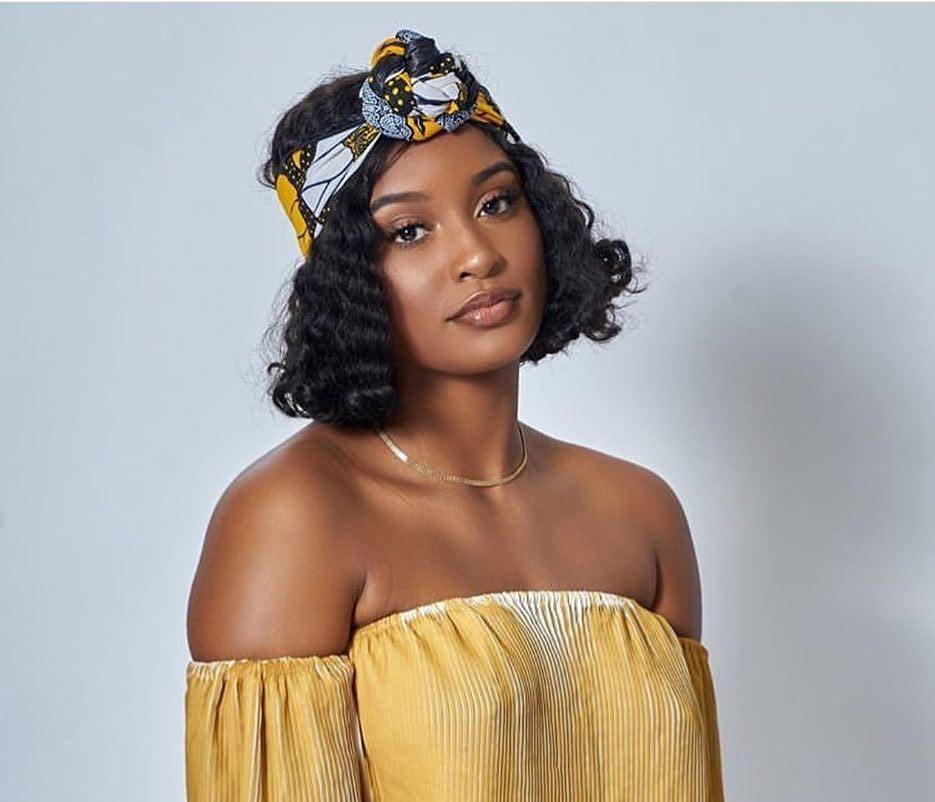 Bandana hairstyles: Woman with dark brown wavy weave with printed bandana around her head