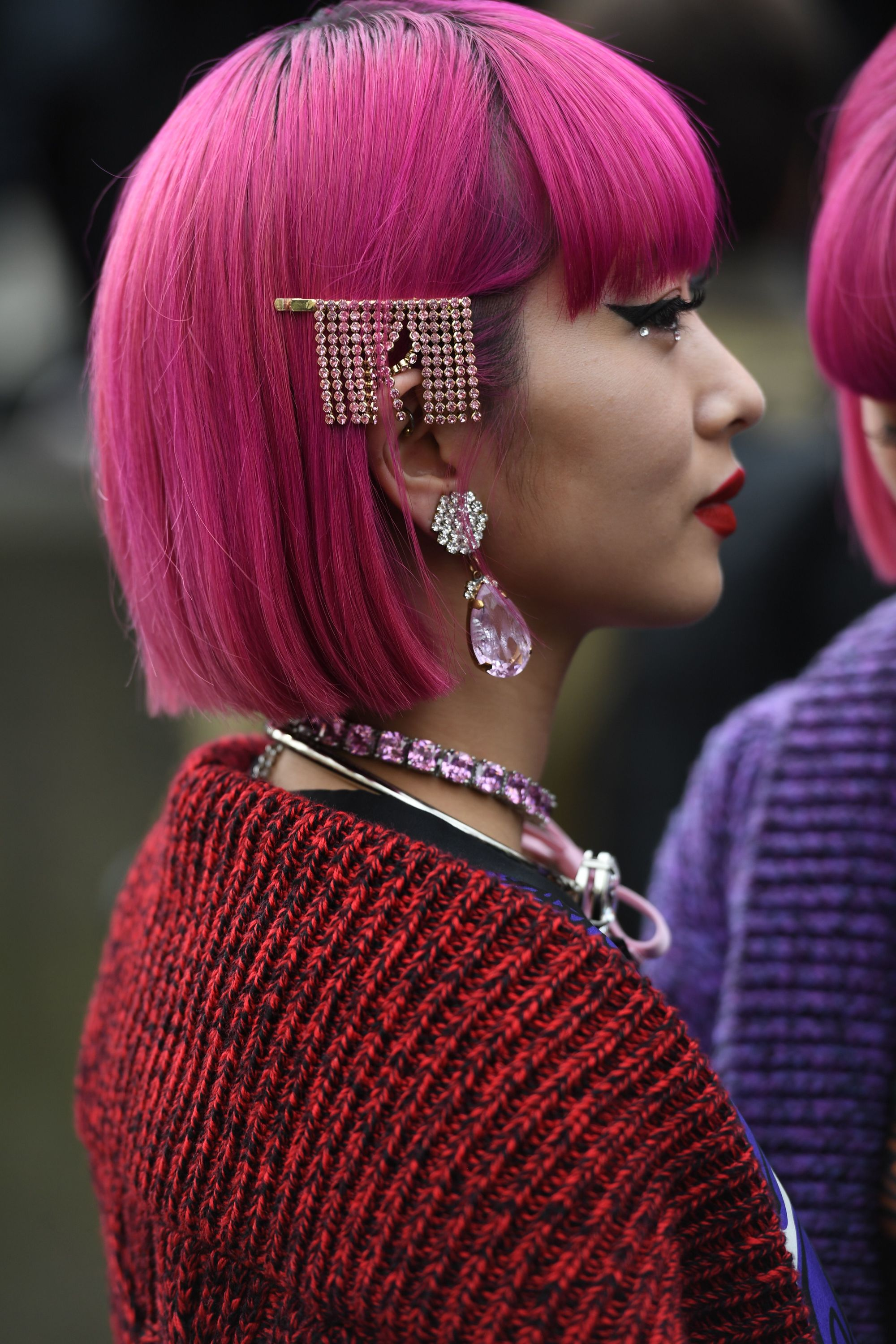 Diamante hair trend: Side photo of a woman with a pink bob wearing a dangling diamante hair slide