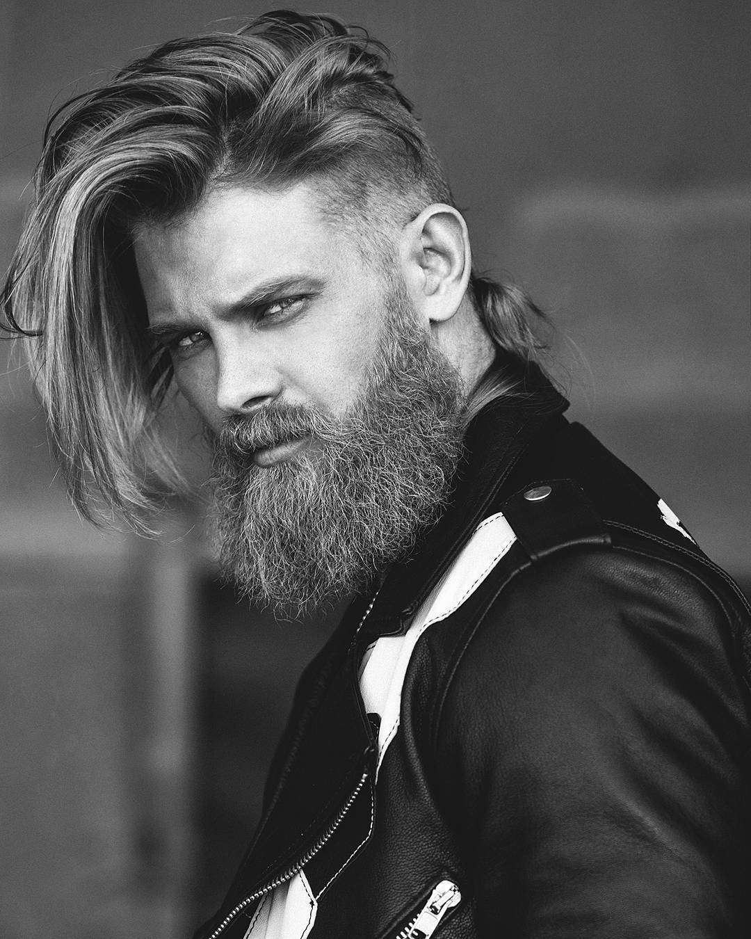 Viking hairstyles: Shot of man with full beard with long top hairstyle with low fade