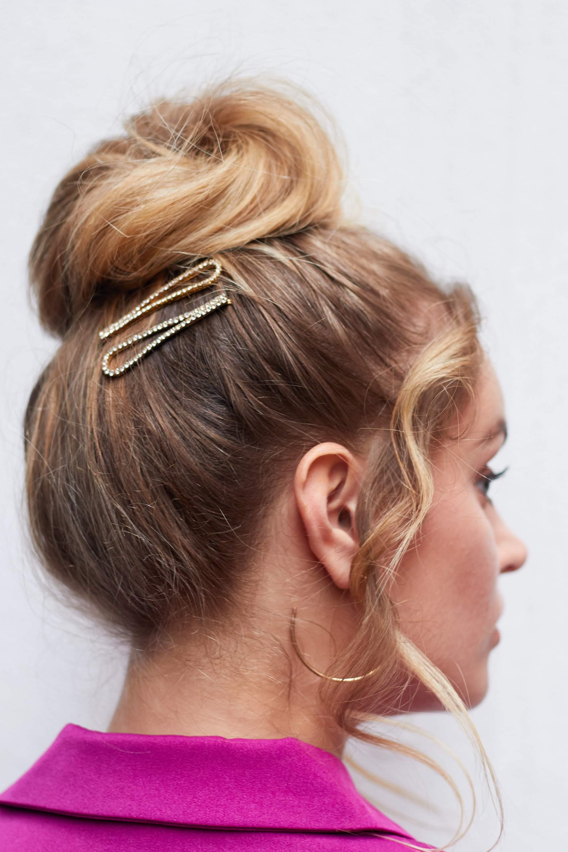 Bridesmaid hairstyles: Woman with ballerina bun updo