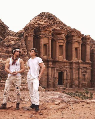 Troy Pes and Zander Hodgson outside monument in Jordan