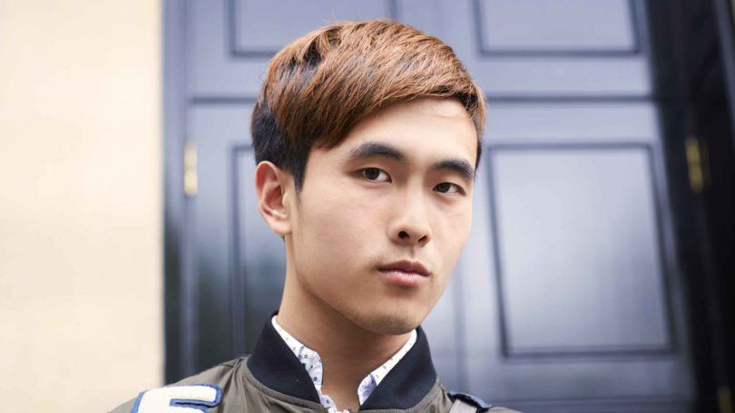 asian man with colored hair
