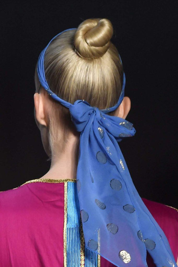 back shot of model with ballerina bun hairstyle and scarf