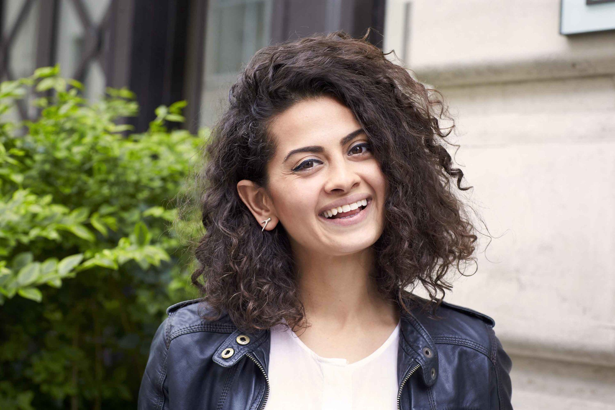 Woman with curly shoulder length haircut