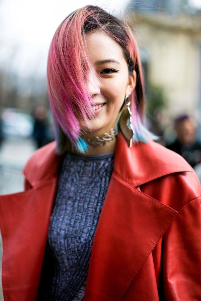 Asian girl with strawberry pink hair ombre short hair