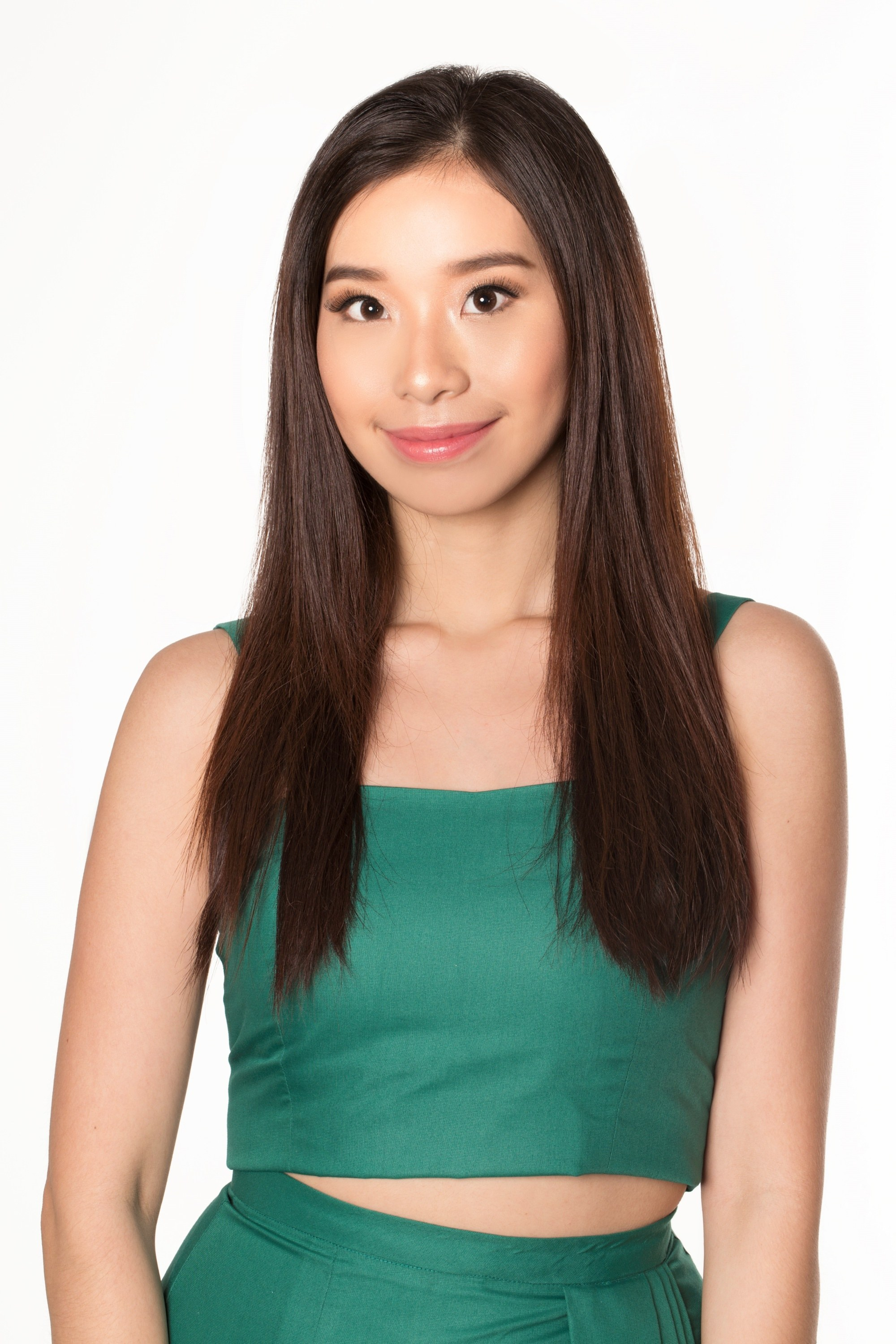 Hair facts: Asian woman with long dark straight hair wearing a green top and skirt