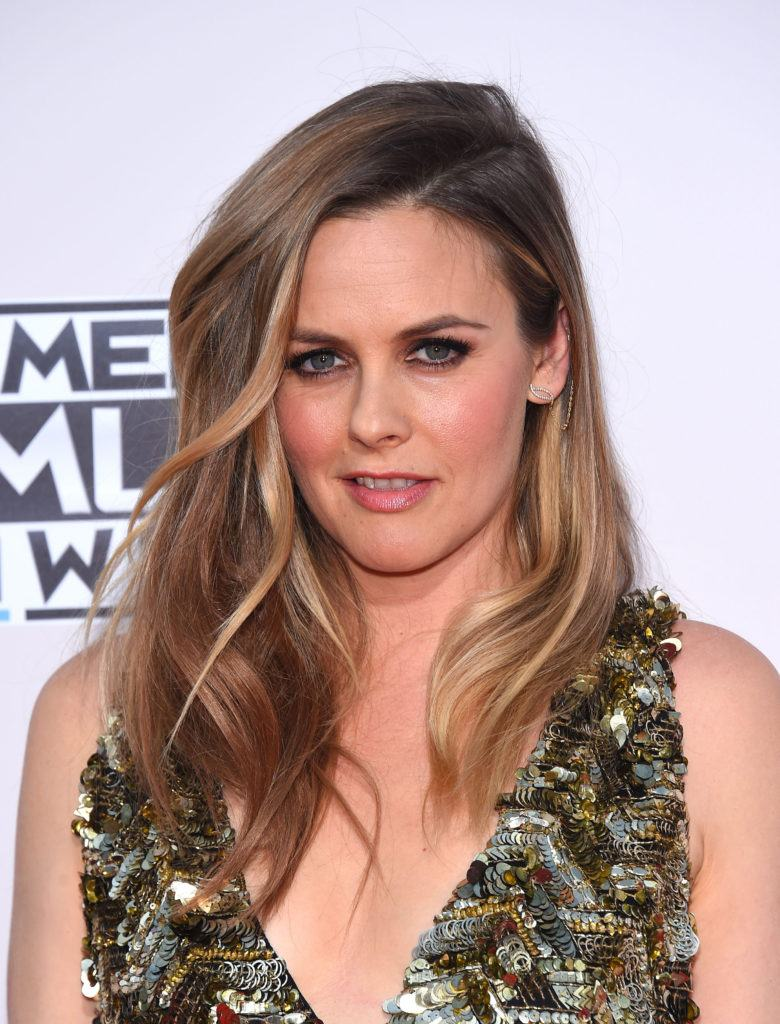 Alicia Silverstone with side flip hairstyle for thin hair