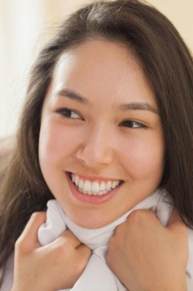 smiling asian girl with long straight hair