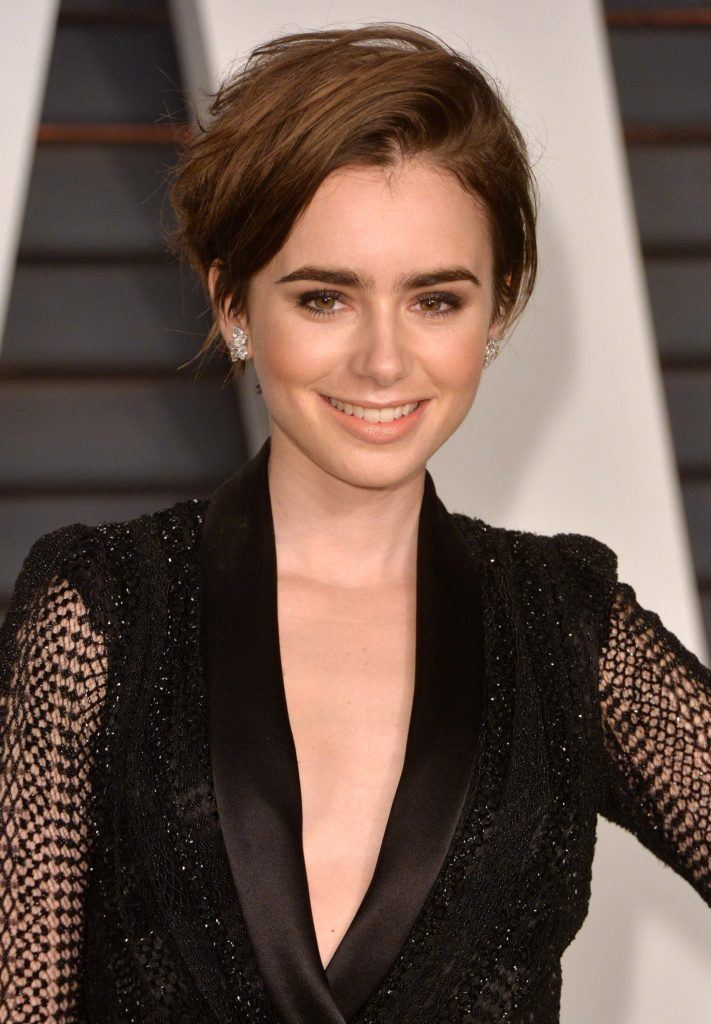 Lily Collins with a pixie cut hairstyle