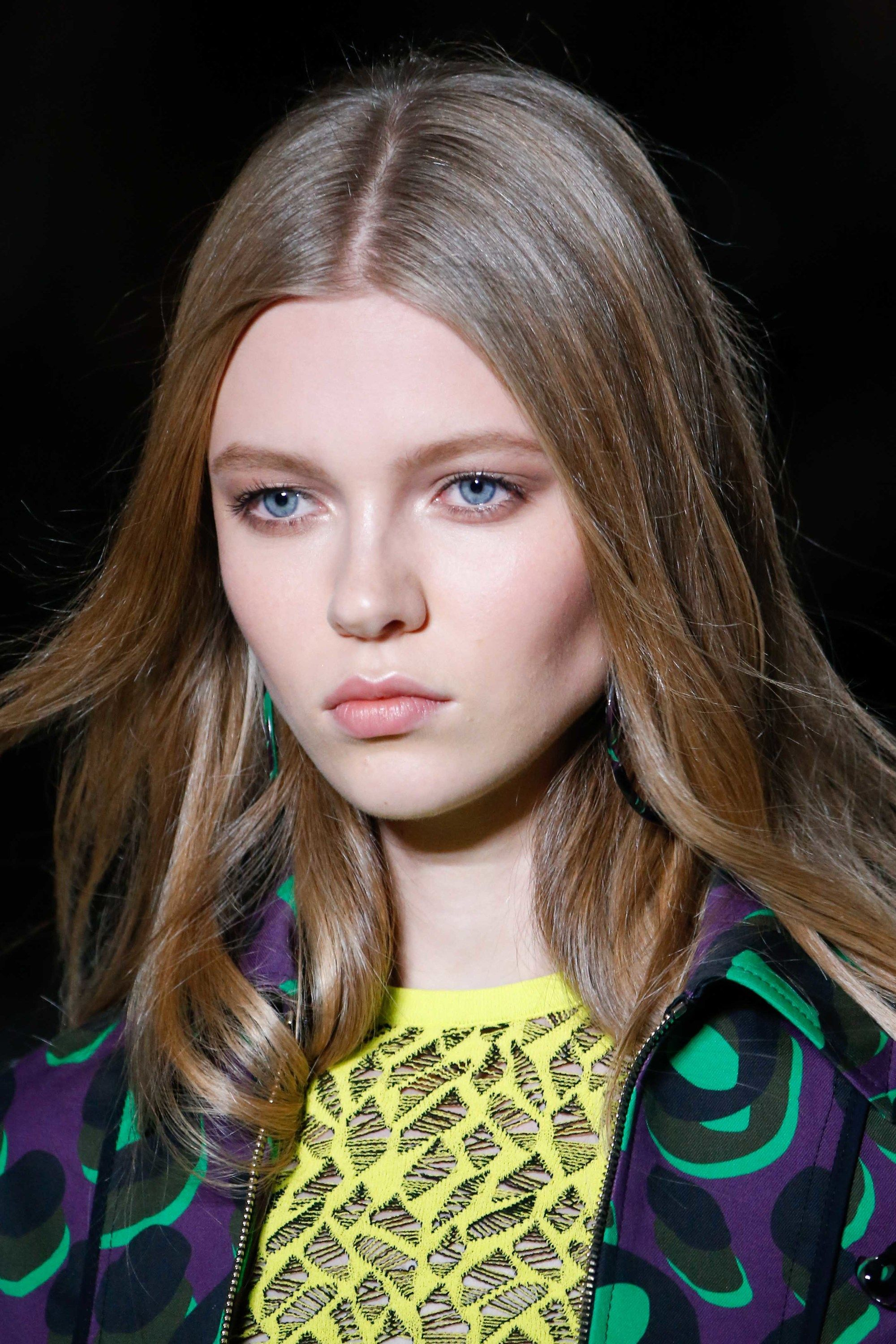 Model with ash brown hair and fair skin on the runway