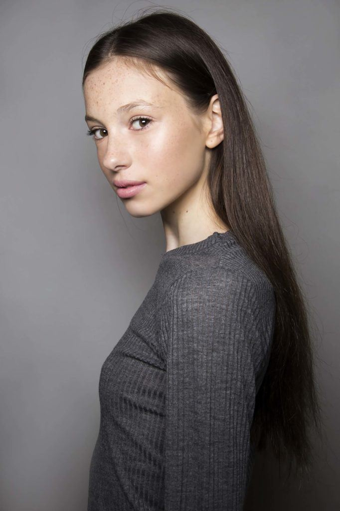 model with long straight brown hair