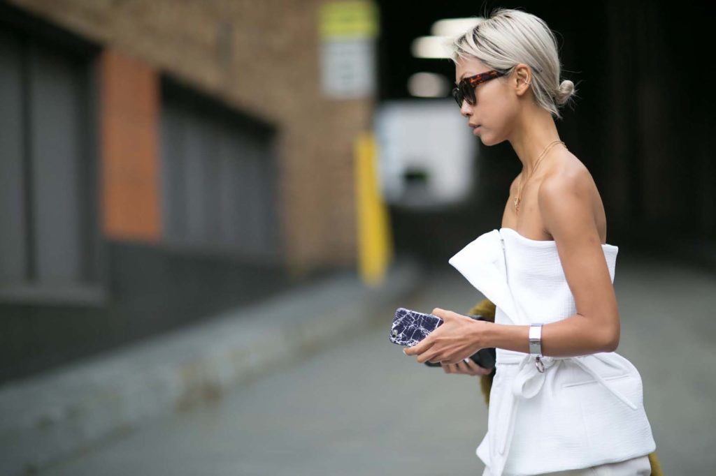 asian girl with blonde low bun hairstyle