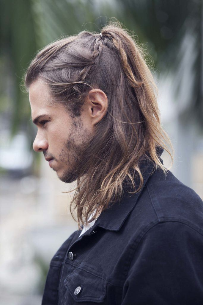 man with side braids