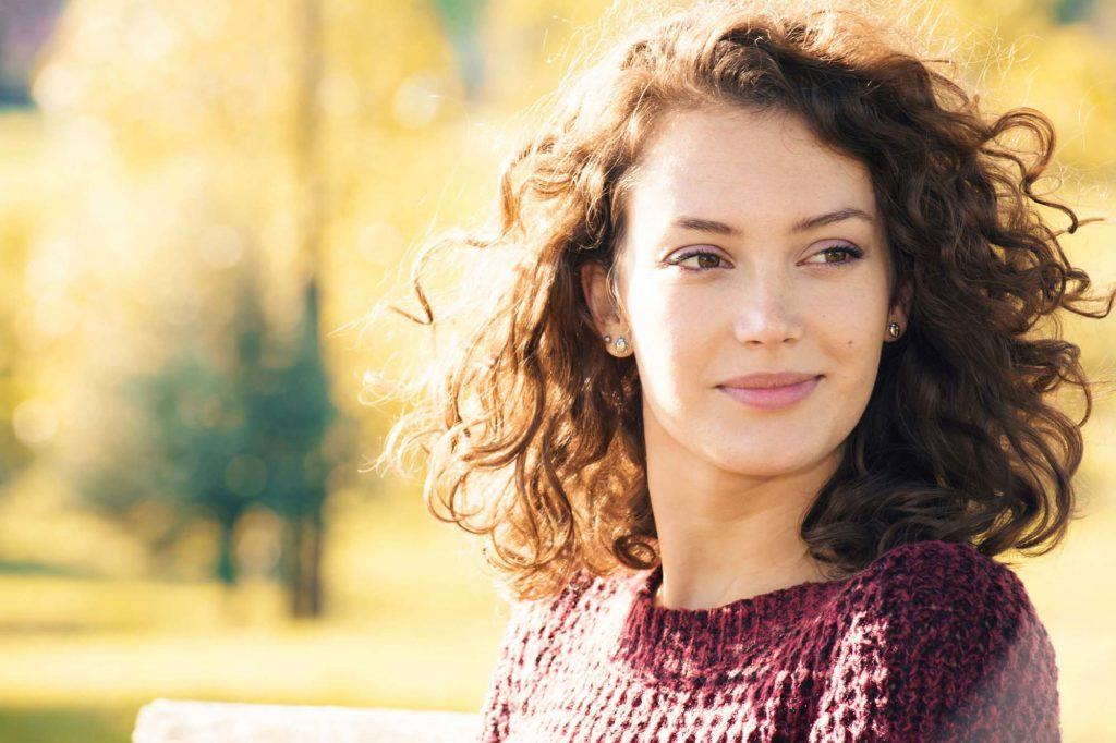 woman with curly medium length haircut
