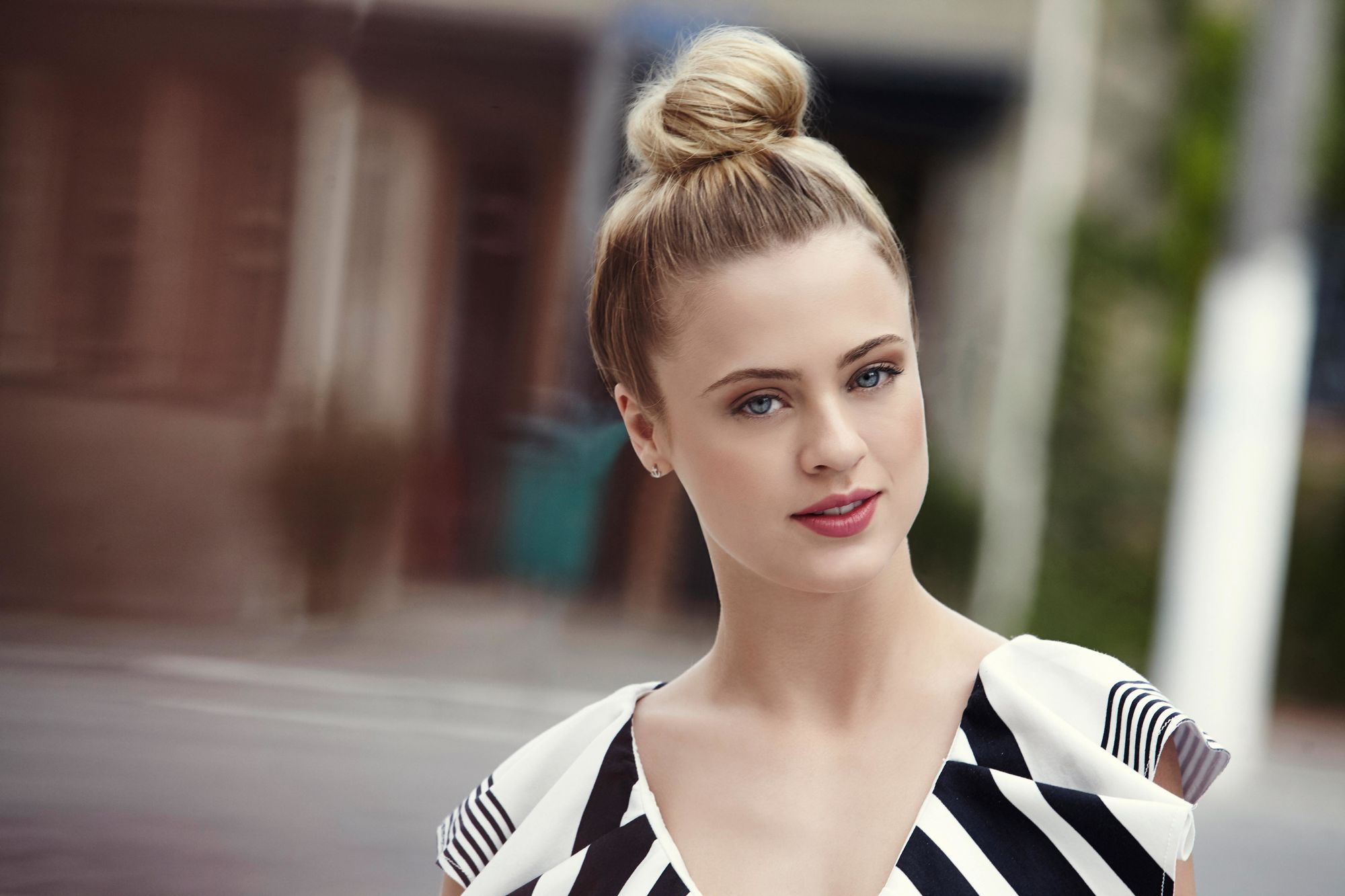 blonde with top knot hair