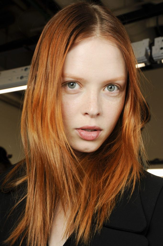 model with bright ginger red hair