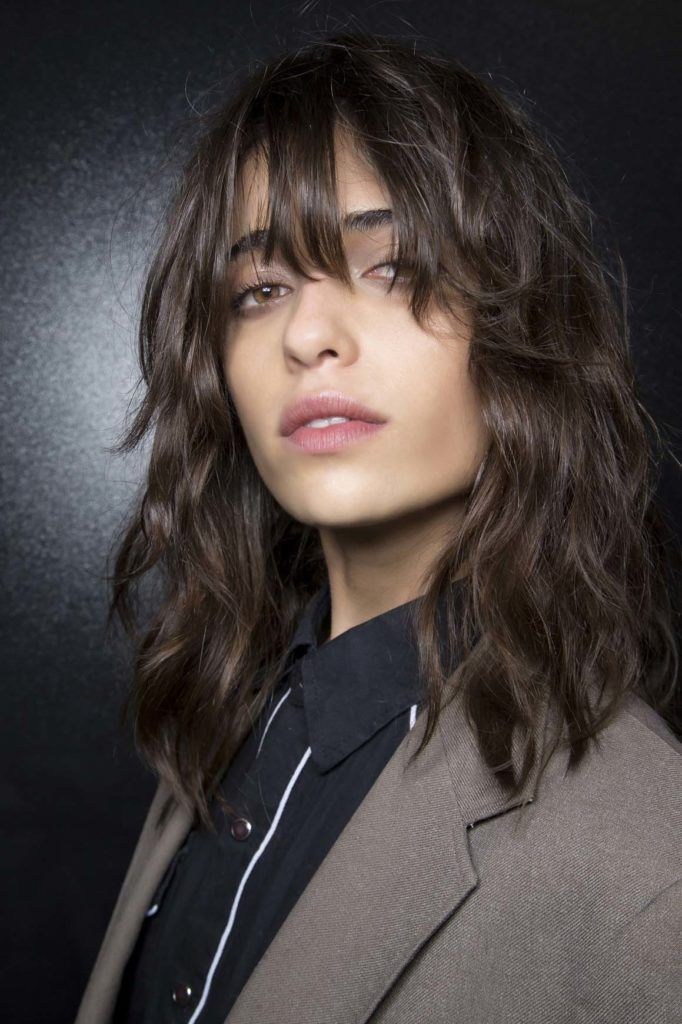 Model with brown shaggy bob styled in a fashion show backstage