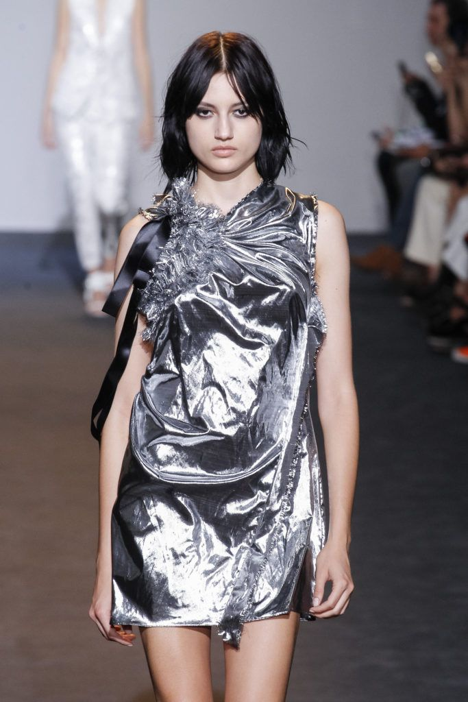 model on the runway with black hair and center parted bangs for fine hair