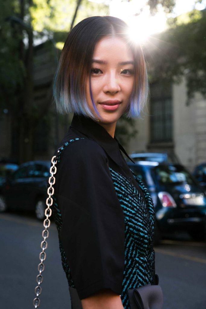 asian girl with textured wispy hair with blue highlights