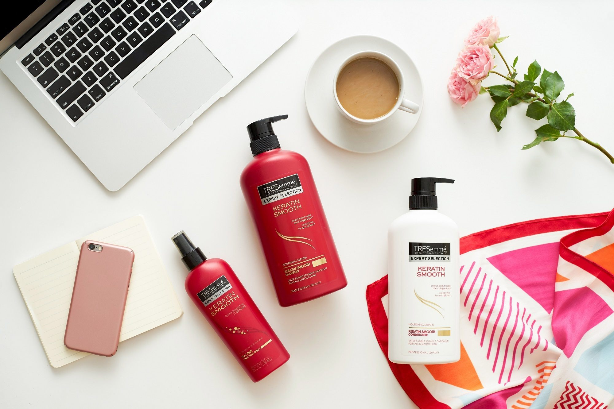 How to get beautiful hair: Flat lay of TRESemme products and office props