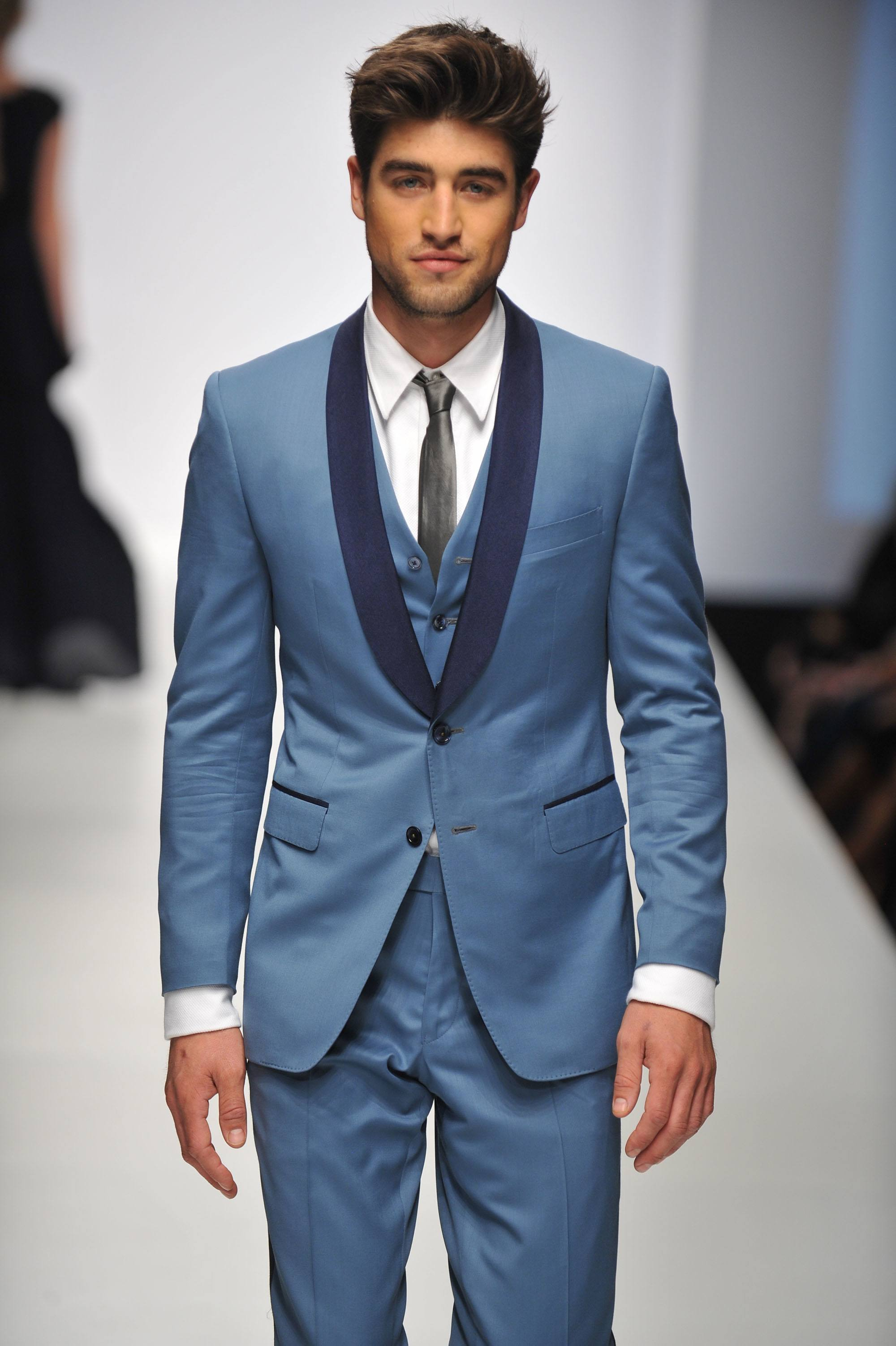 model on the runway with textured quiff hairstyle men's hair wax