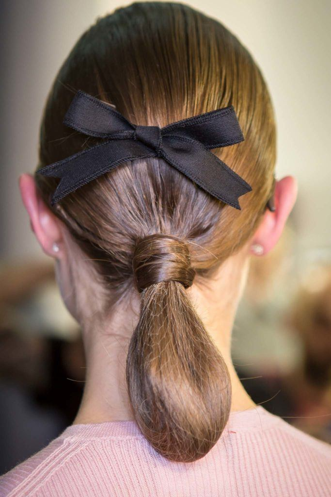 everyday hairstyles for work rolled up ponytail