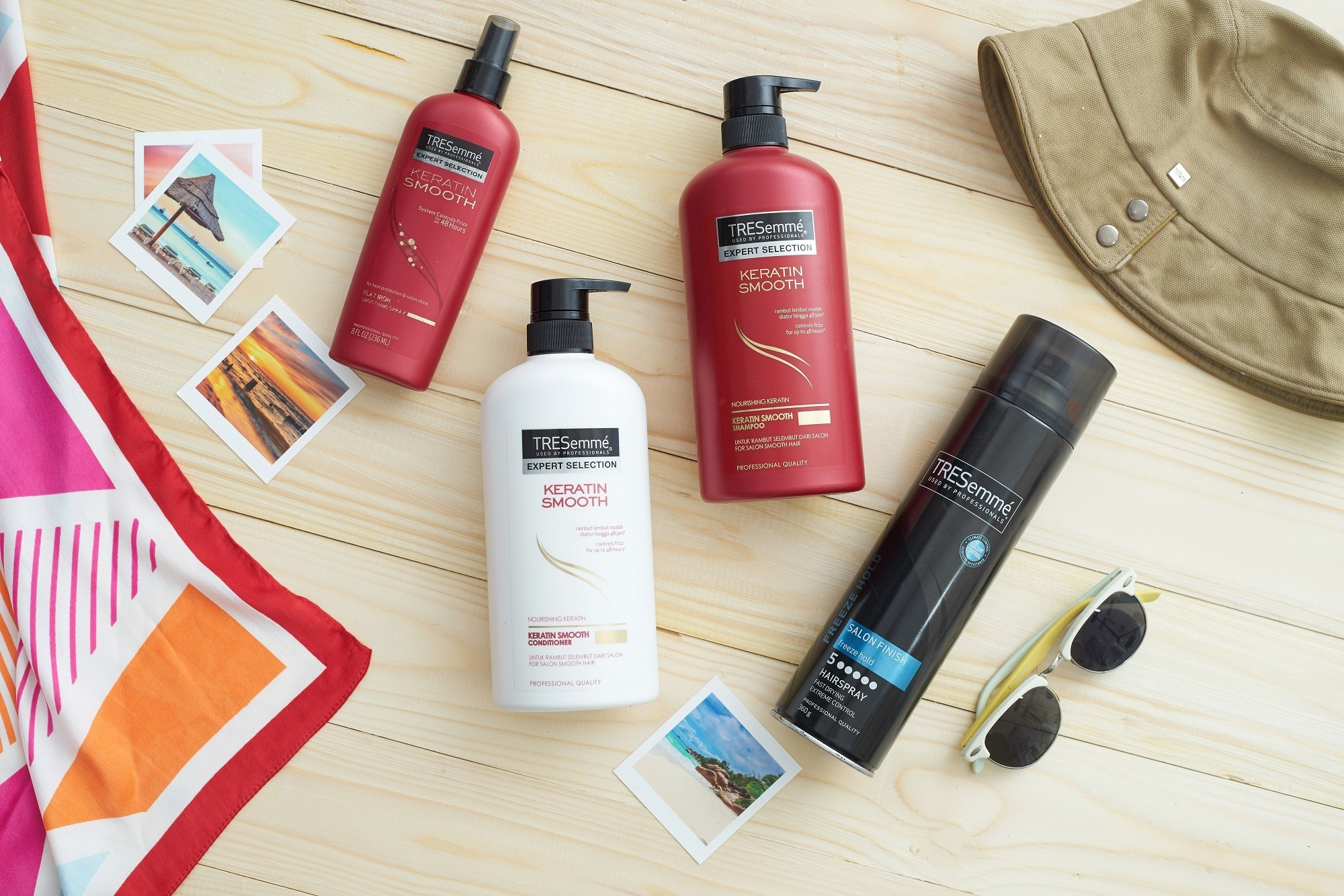 Hair care tips for traveling: flat lay of hair products with bandanna and hat