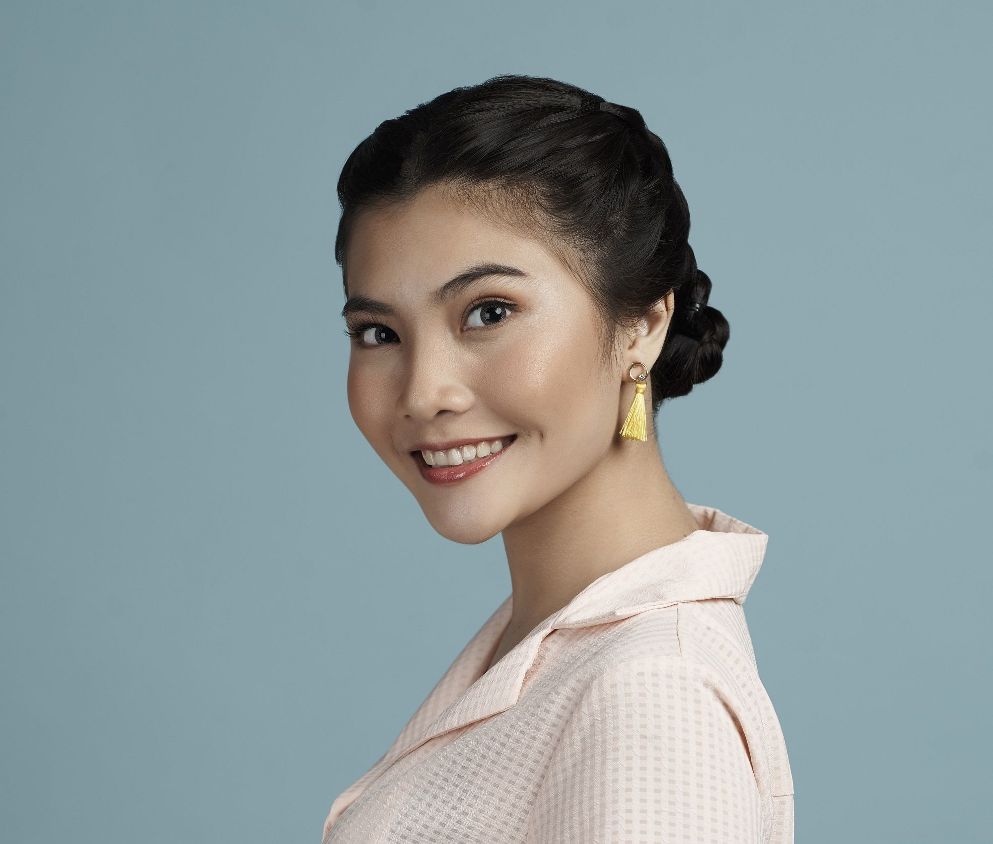 Easy commuter-friendly hairstyles: Closeup shot of an Asian woman with black hair in double Dutch braid