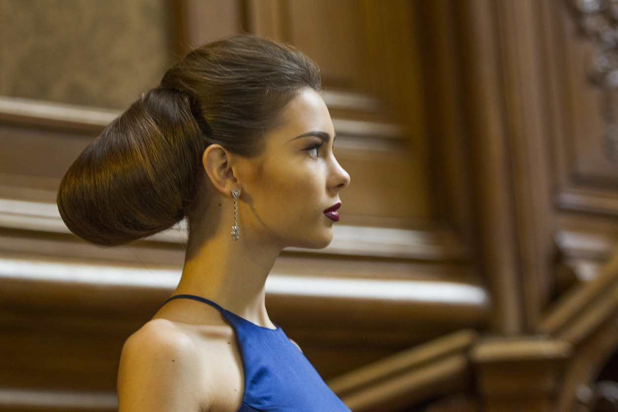 Ukranian female model with prom updo hairstyle posing at historical building in lviv ukraine