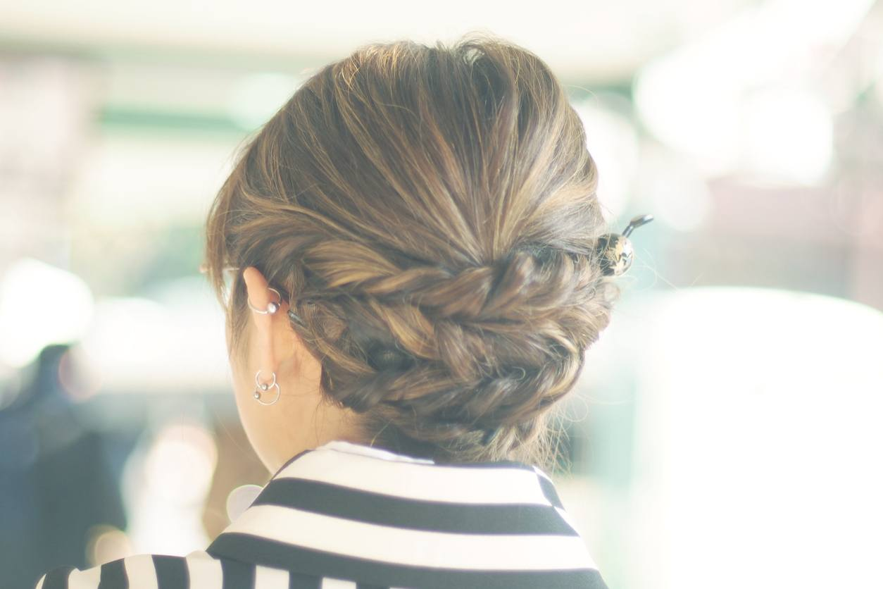 Woman's braid hairstyle getting ready for prom wearing kimono